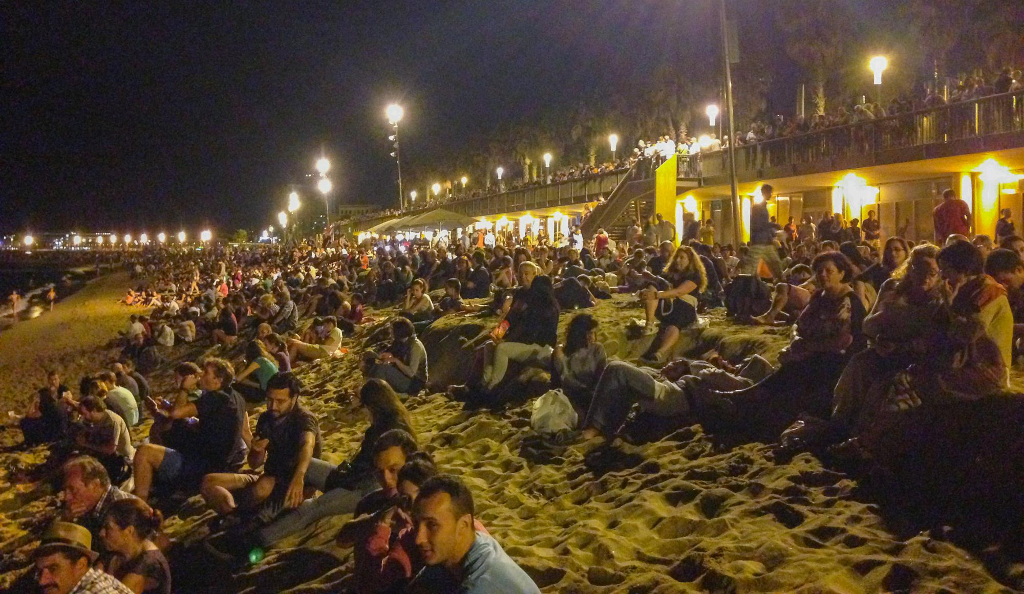 People are waiting for the fireworks on the beach of Barceloneta